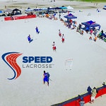 Image of pros playing speed lacrosse at the beach festival